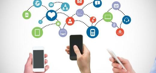 digital composite of hands using smartphones with graphics